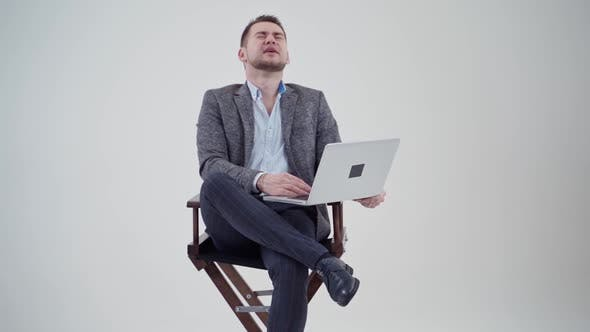 Cover Image for Businessman With Laptop in Studio