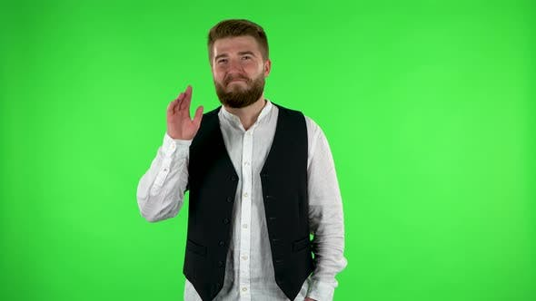 Thumbnail for Man Waving Hand and Showing Gesture Come Here. Green Screen