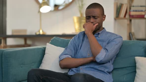 Thumbnail for Young African Man Sitting and Crying on Sofa