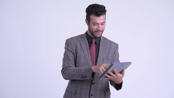 Thumbnail for Happy Bearded Persian Businessman Thinking While Using Digital Tablet