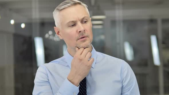 Thumbnail for Thinking Grey Hair Businessman in Office, Brainstorming