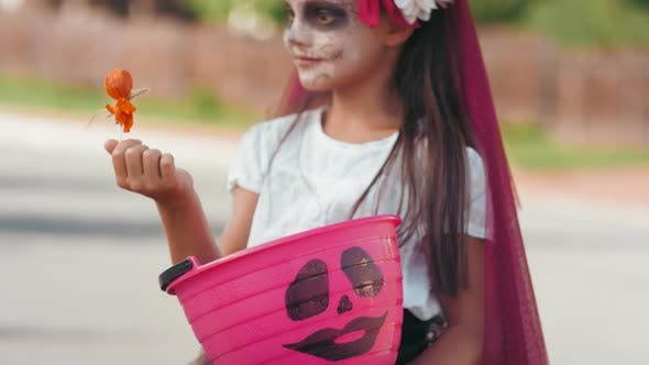 Thumbnail for Ecstatic Girl in Halloween Costume Posing after Trick-or-Treating