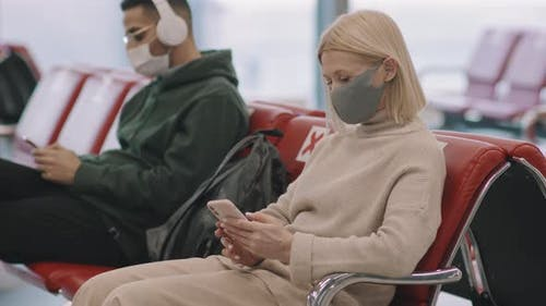 People Waiting In Departure Lounge