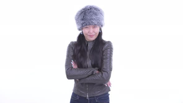 Thumbnail for Happy Beautiful Asian Woman Smiling with Arms Crossed Ready for Winter