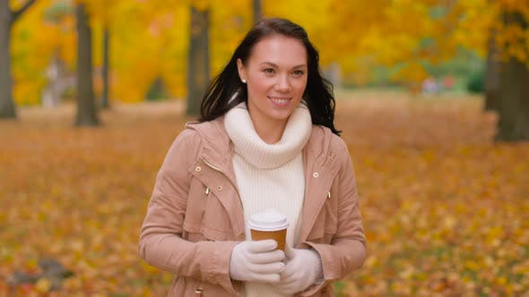 Thumbnail for Woman Drinking Takeaway Coffee in Autumn Park 9