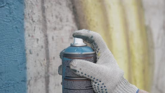 Cover Image for Graffiti Artist Hands with Paint Cans