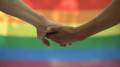 Gay Stroking Partner Hand Lgbt Flag Background, Rights Equality Pride March