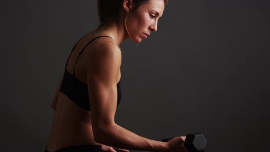 Thumbnail for Healthy woman lifting weights
