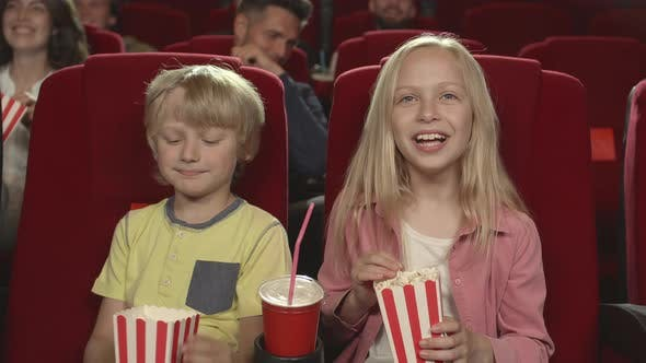 Thumbnail for Two Children Watching Cartoon in Cinema