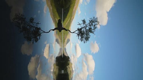 Vertical View of Tranquil Lake Scene with Reflection of Tree & Sky - Static Tripod