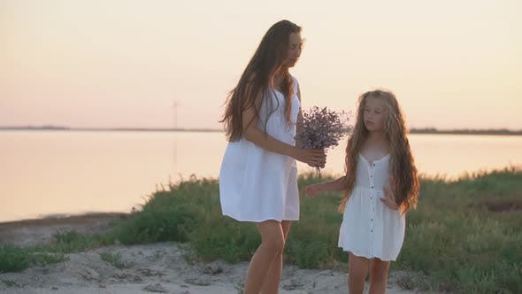 Cover Image for Mother and Daughter Strolling Near the Sea