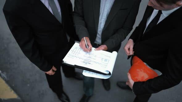 Cover Image for Business People Signing Architecture Documents