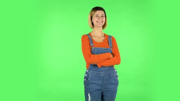 Thumbnail for Girl Listens Carefully, Threatens with a Finger and Waves Her Head Seductively. Green Screen