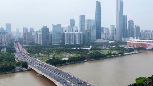Thumbnail for Guangzhou Business City Aerial Cityscape China Pearl River with Boats Traffic and Bridges Timelapse