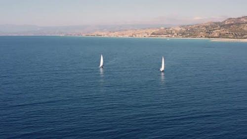 Two sailboats near the beach