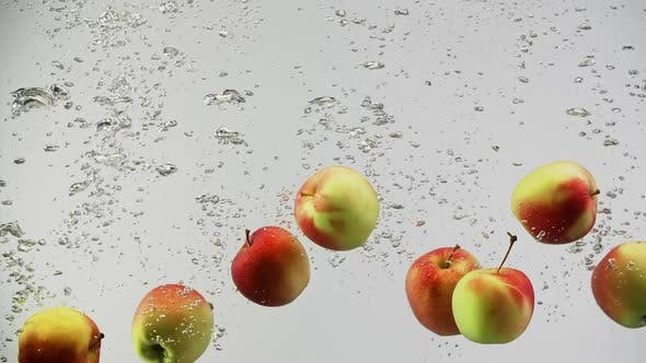 Thumbnail for Fresh Colorful Apples Falling in Splash of Water with Air Bubbles