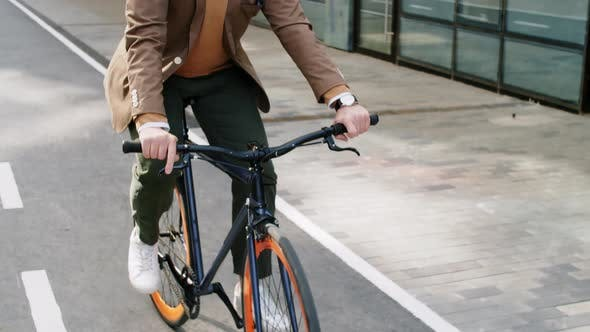 Businessman Riding Bicycle in the City