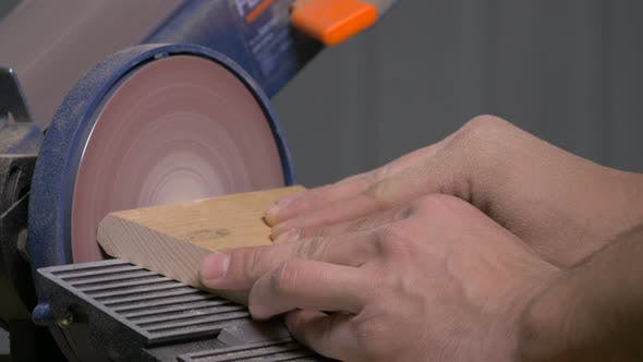 Thumbnail for Sanding a piece of wood
