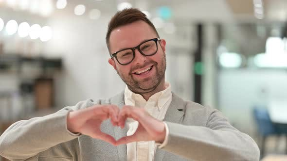 Creative Man Showing Heart Gesture