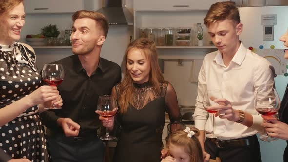Thumbnail for People Stand Around the Table and Laugh