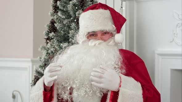 Thumbnail for Santa Claus Rubbing His Beard and Talking About Christmas Looking at the Camera