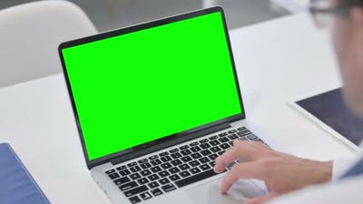 Man using Laptop with Green Chroma Screen