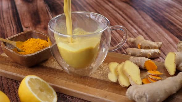 Thumbnail for Immunity Boosting Antivirus Drink. Healthy Turmeric Latte Drink In A Glass Cup.