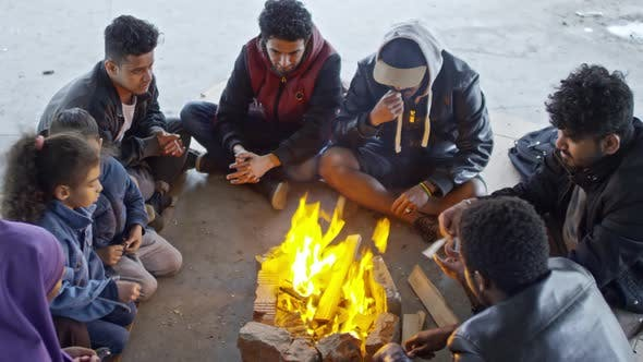 Thumbnail for Syrian Refugees Sitting by Fire