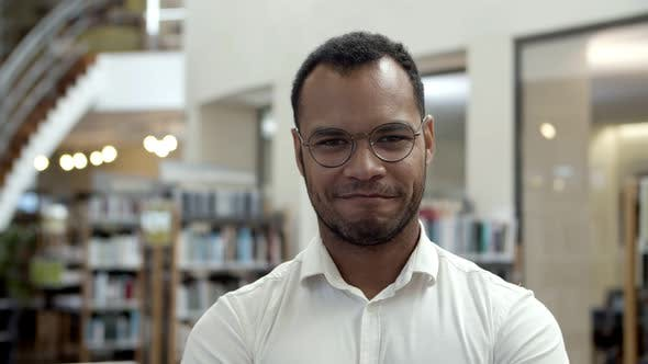 Thumbnail for Smiling African American Man Posing at Public Library