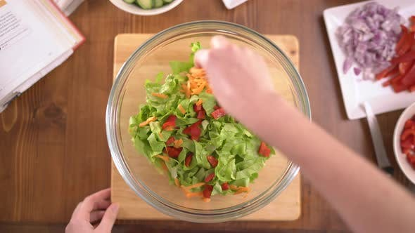Thumbnail for Adding vegetables to a salad