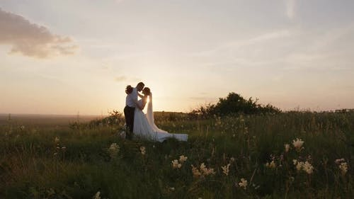 Couple Kissing and the Fascinating Evening Sunset