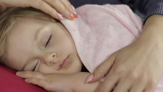 Thumbnail for Young Mother Taking Care of Her Little Baby Girl While She Sleep. Girl on Bed
