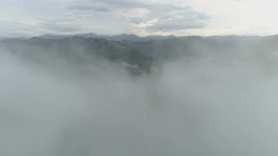 Thumbnail for Drone Flying Through Dense Fog in the Mountains in Cloudy Summer Day