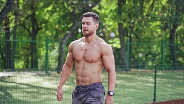 Thumbnail for Muscular runner on the outdoor stadium