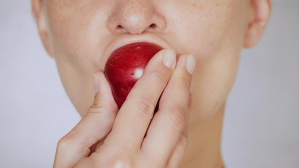 Thumbnail for Close Up Face Young Woman Eating Plum