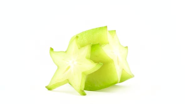 Thumbnail for One Half and One Slice of Ripe Carambola Fruit. Rotating on the Turntable Isolated