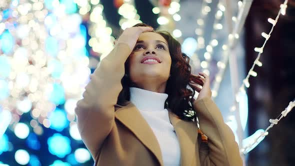 Thumbnail for Closeup Portrait of a Young Woman on the Background of Festive Lights and Bokeh. Girl Enjoys the