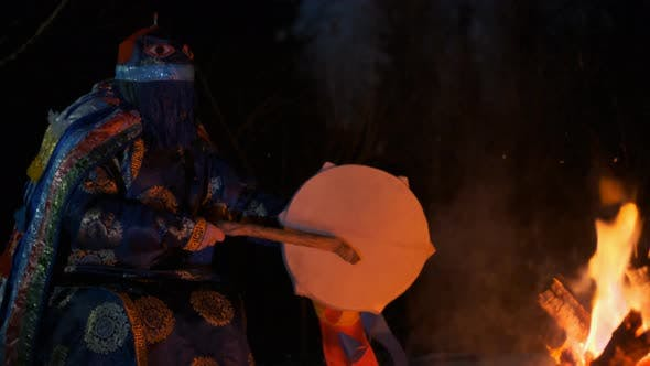 Thumbnail for Slow Motion Portrait of a Shaman Singing a Song