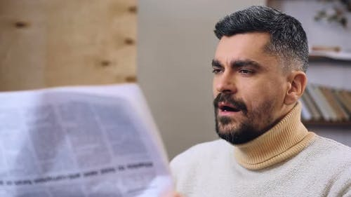 Sleepy Bearded Man Trying to Read Daily Newspaper, Boring News, Routine Life