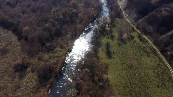 Thumbnail for Aerial Shot of the Oskol River and Many Trees in Warm Sunny Weather in Dvurechansky Park, Kharkov
