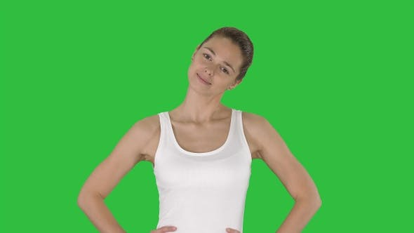Cover Image for Woman stretching neck while walking on a Green Screen, Chroma Key.