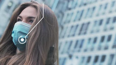 2d Animation Covid-19 Appearing Out of Protective Mask of Young Brunette Woman Standing Outdoors