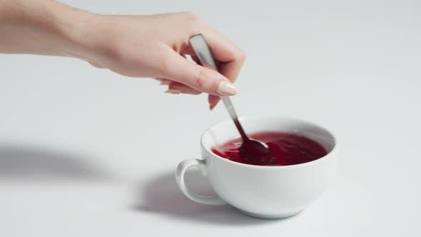 Thumbnail for Stirring the tea