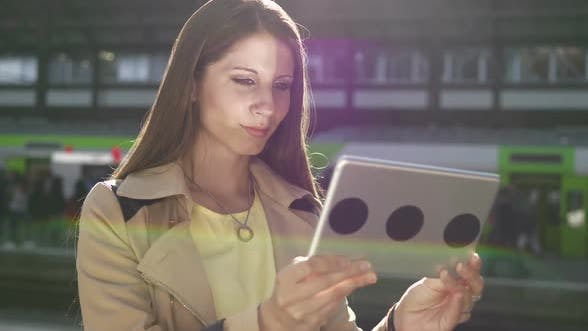 Thumbnail for Attractive Young Woman Using Digital Tablet Screen