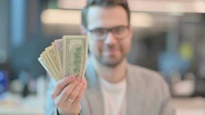 Portrait of Confident Man Holding Dollars