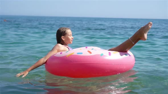 Thumbnail for Adorable Girl on Inflatable Air Mattress in the Sea