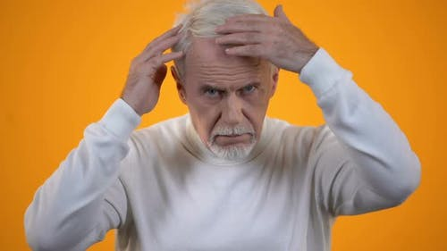 Senior Male Touching Head, Upset With Hair Loss, Trichology and Health Care