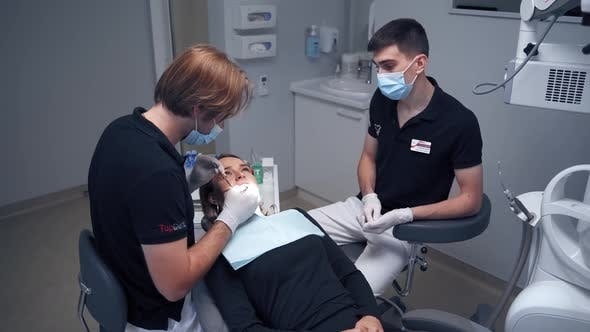 Thumbnail for Dentist at work in clinic. Woman at the dentist while treatment process at the dental clinic