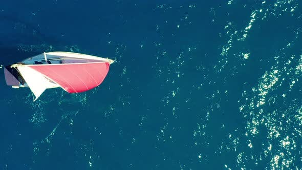 Thumbnail for Aerial View. Beautiful Sailboat on Background Blue Ocean on a Bright Sunny Day