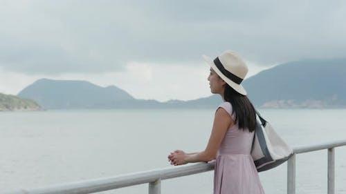 Woman look at sea at summer time